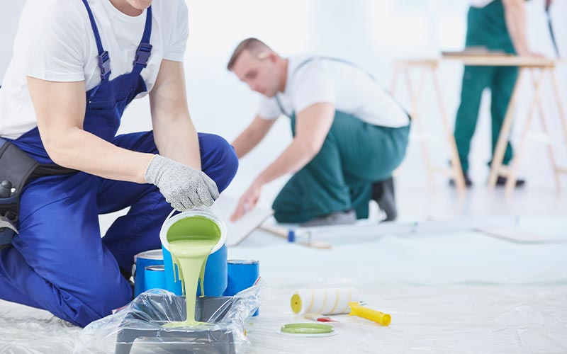 painters pouring paint